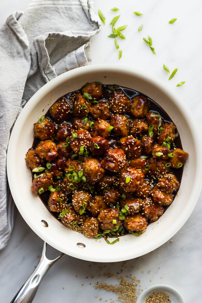 Mini Asian Chicken Meatballs - tender chicken meatballs in a delicious asian inspired sauce. SO good for the holidays! | littlebroken.com @littlebroken