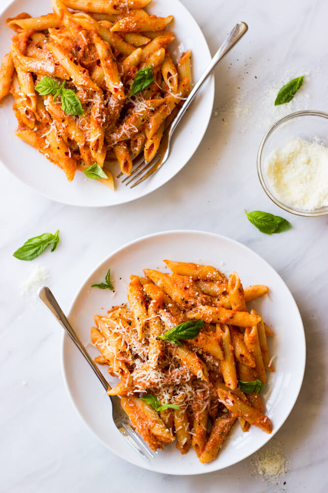 Vodka sauce with pasta in white bowl
