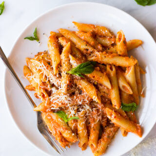 Vodka Sauce Recipe - lightened up creamy pink vodka sauce recipe. So easy, so delicious! You'll never go back to jarred sauce ever again. | littlebroken.com @littlebroken
