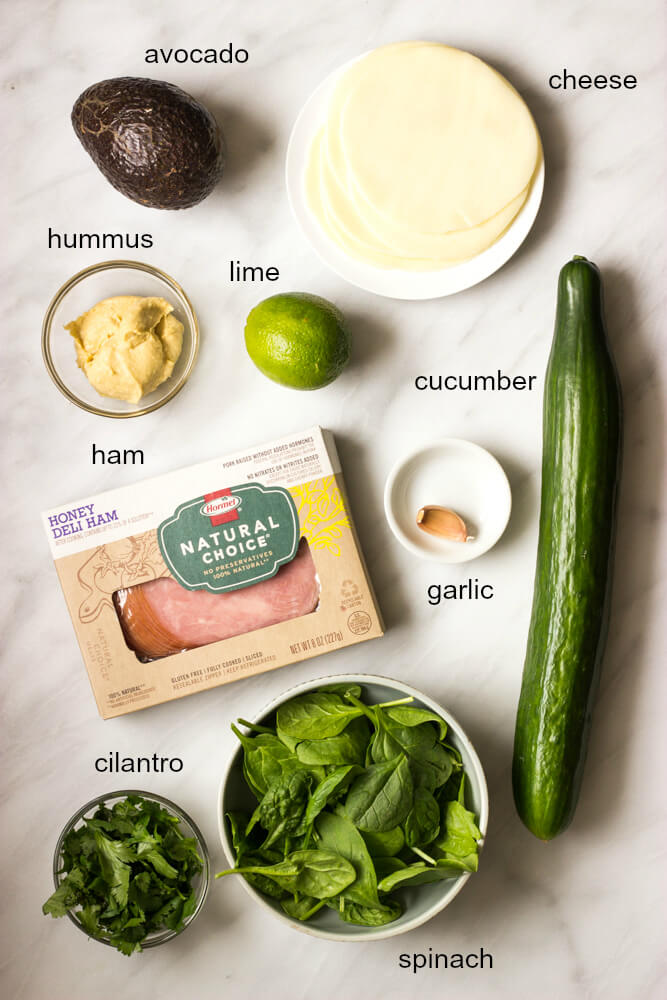 Ham and Cheese Cucumber Roll Ups - low carb and healthy roll ups with avocado-hummus, ham, cheese, cilantro, and spinach   littlebroken.com