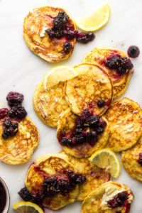 Lemon Ricotta Pancakes with Fruit Syrup - naturally sweetened with honey and made with white whole wheat flour these pancakes are served with two-ingredient fruit syrup | littlebroken.com @littlebroken