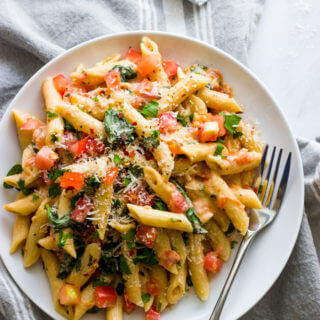 Pasta with Fresh Tomato Cream Sauce (Lightened Up) - easy, meatless pasta dish made with milk instead of cream, fresh tomatoes, and spinach | littlebroken.com @littlebroken