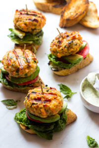 Open-Faced Salmon Burgers - made with fresh salmon and served on toasted baguette with tomato, lettuce, avocado, and basil mayo. These are healthy and quick to make!   littlebroken.com @littlebroken