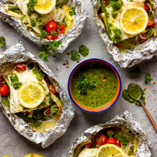Baked Fish and Vegetables in Foil with Chimichurri Sauce - white fish baked in foil with green beans, zucchini, tomatoes, then served with chimichurri sauce | littlebroken.com @littlebroken