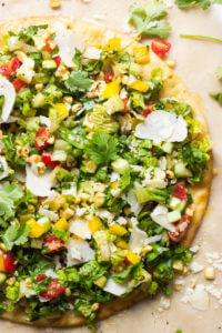 Summer Salad Flatbread - parmesan crusted flatbread topped with chopped summer salad, balsamic dressing, and shaved parmesan | littlebroken.com @littlebroken