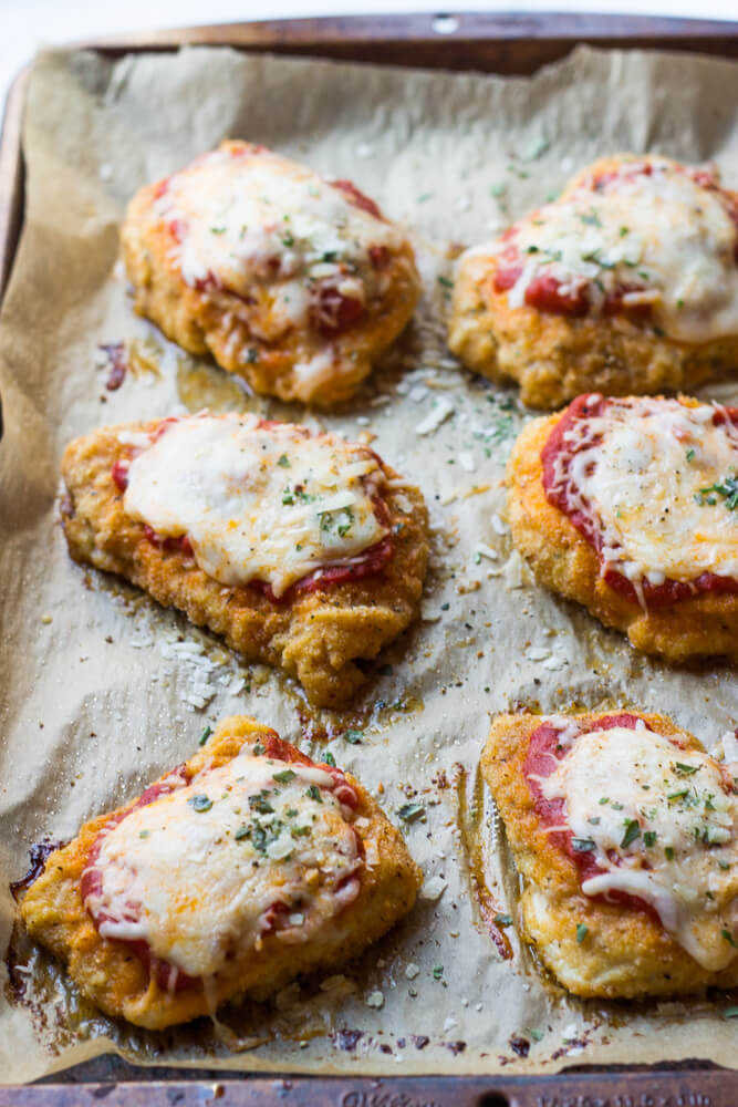 Baked Chicken Parmesan - lightly breaded chicken breast topped with marinara sauce and cheese, then baked until tender crisp. It's healthy and quick to make! | littlebroken.com @littlebroken