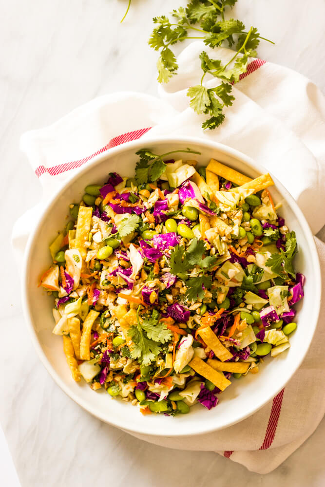 Crunchy Asian Chopped Salad - cabbage, edamame, cilantro, cashews, and insanely delicious sesame dressing! | littlebroken.com @littlebroken