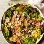 Steak salad in white bowl