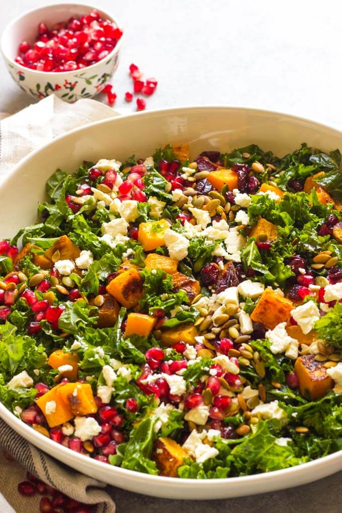 Close up side view of kale salad in white bowl
