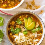 Close up of turkey tortilla soup in white bowl
