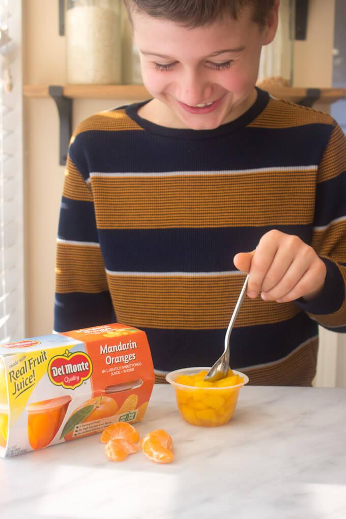 Close up of boy eating fruit snack