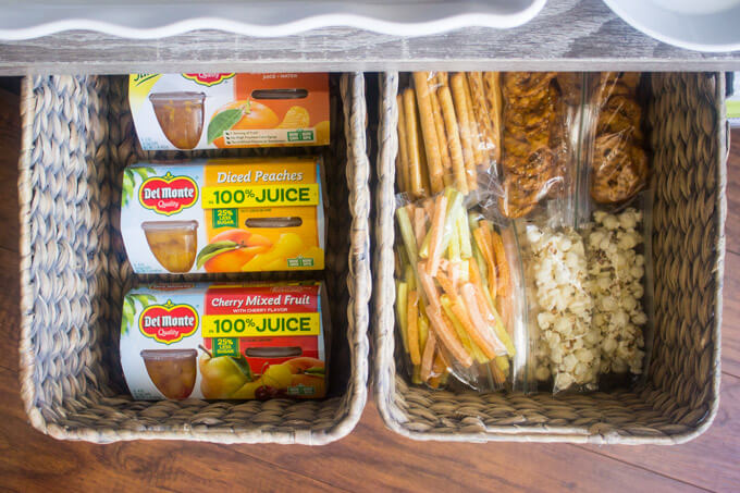 Storage bins with dry snacks for make ahead lunches