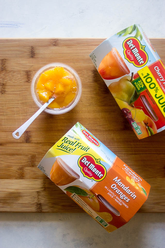 Open fruit cups to pack for school lunches