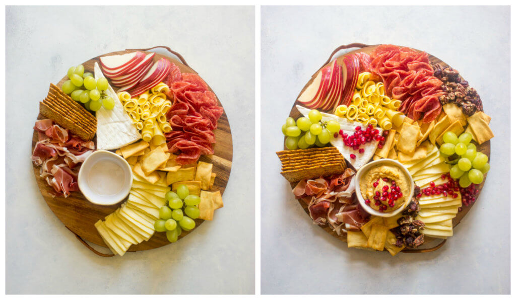Sliced meat and cheese with fruit on a wooden board