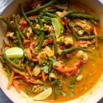 Close up easy chicken vegetable curry in white saute pan