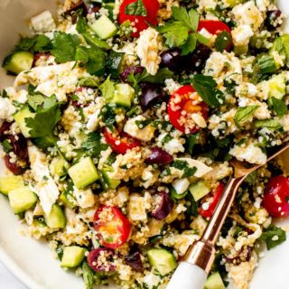 Close up of lemon chicken quinoa salad in white bowl