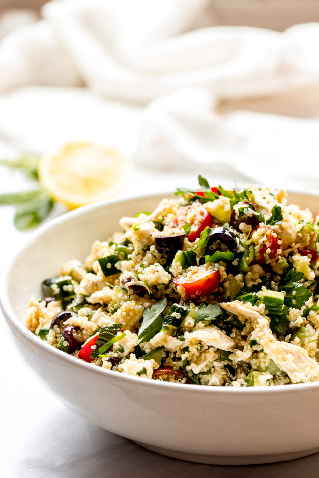 Close up side view lemon chicken quinoa salad