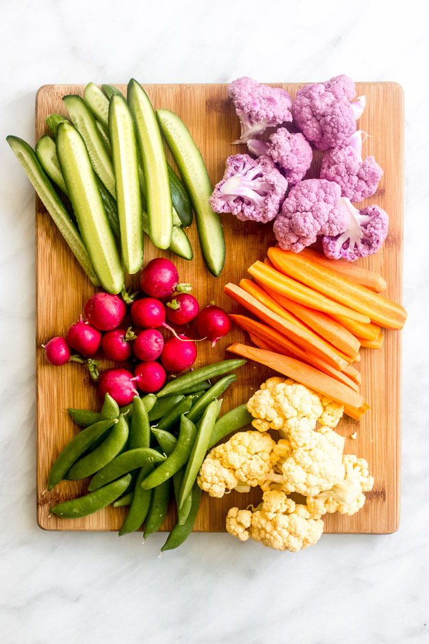 Cut up vegetables on wooden board