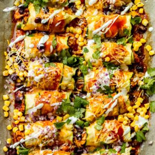 Overhead zucchini chicken enchiladas in sheet pan
