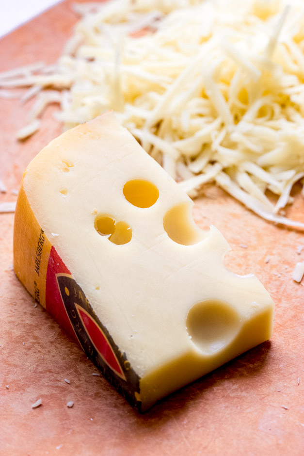Wedge of cheese on board