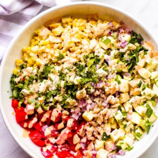 Creamy zucchini corn salad recipe in white bowl