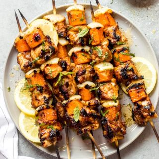 Overhead spicy honey chicken kebabs