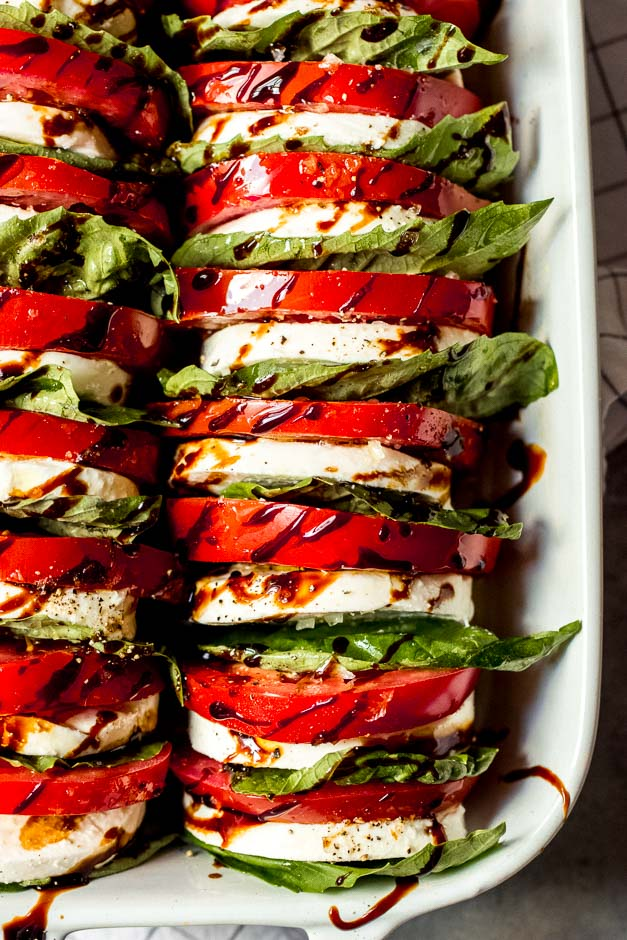 Balsamic reduction drizzled over tomato mozzarella salad recipe