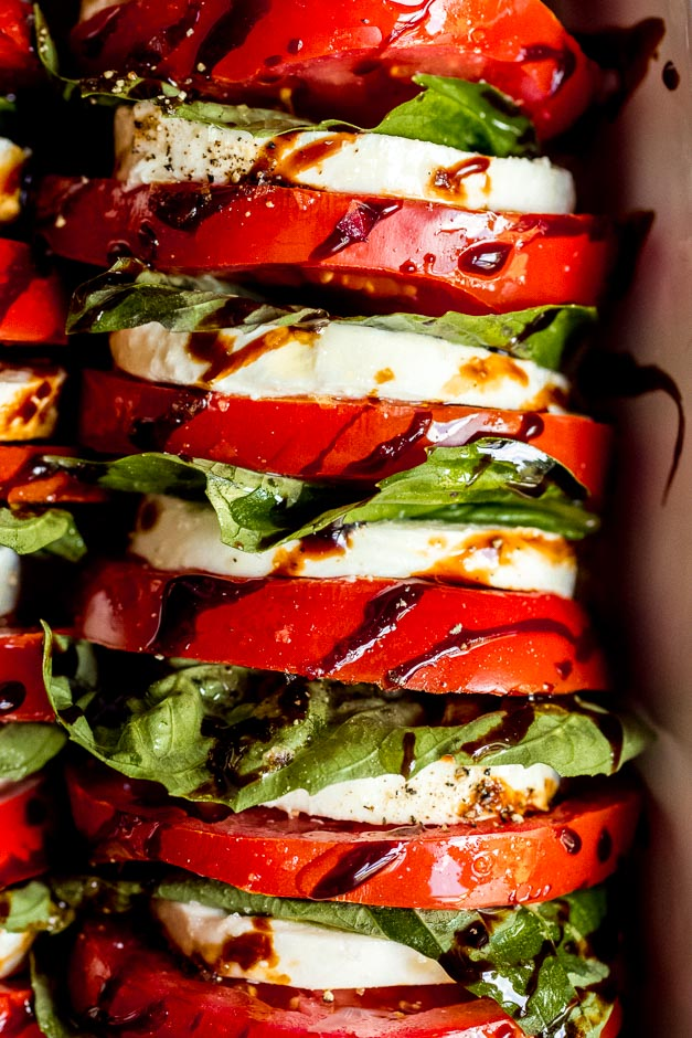 Close up tomato mozzarella salad with balsamic reduction