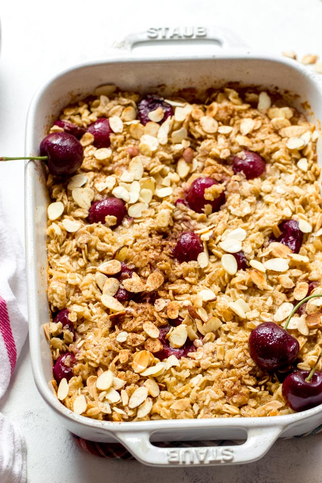 Oatmeal bake with cherries in white casserole