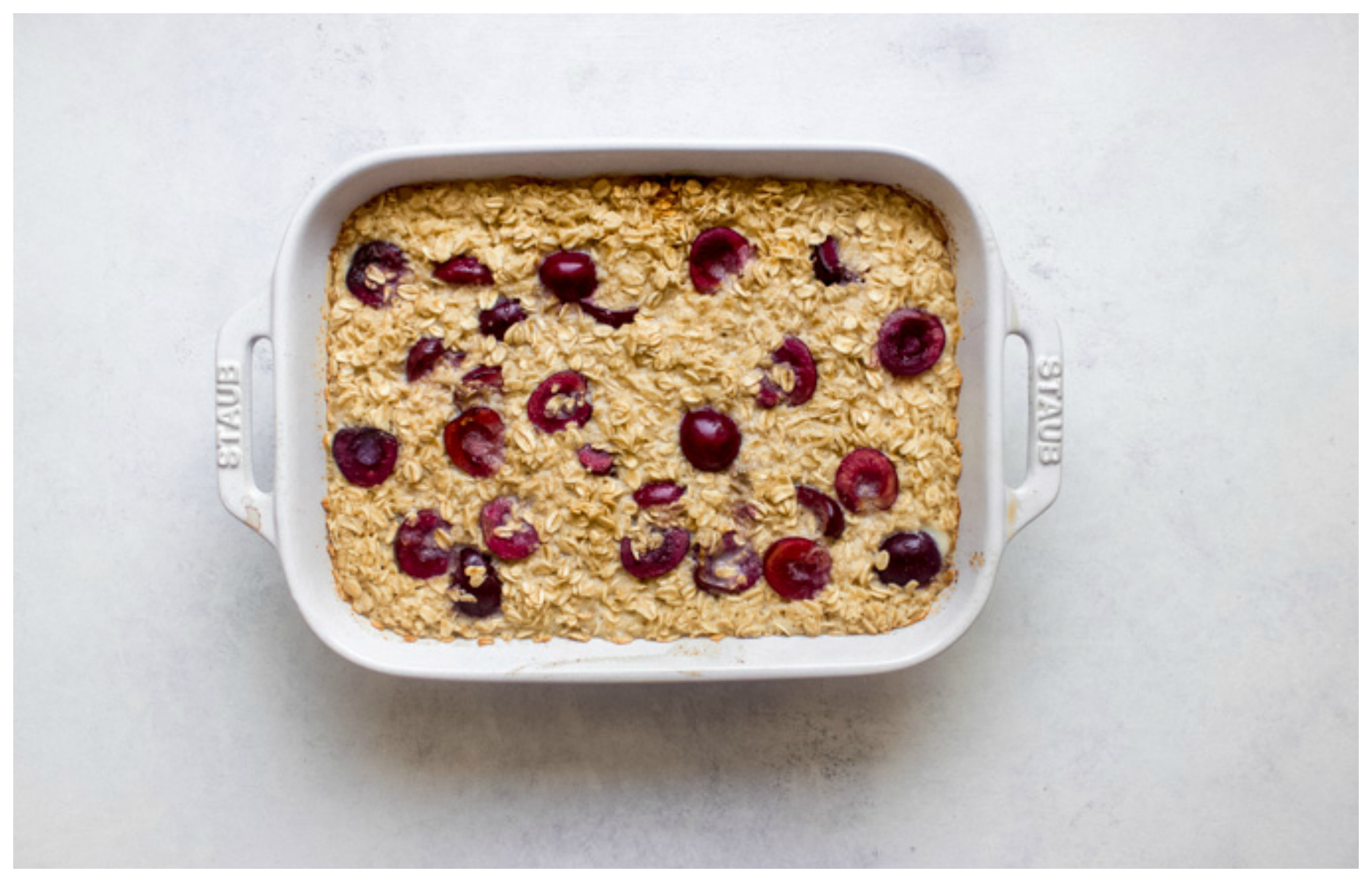 Baked oatmeal with cherries and milk