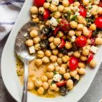 Close up greek chickpea salad with oregano vinaigrette
