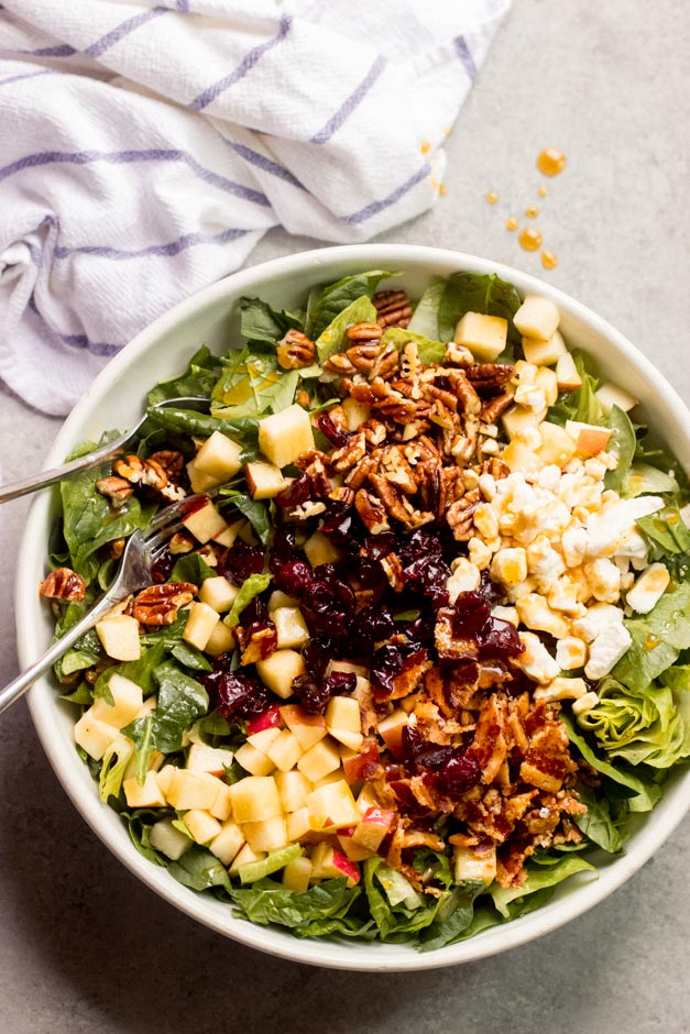 close up spinach salad with apples