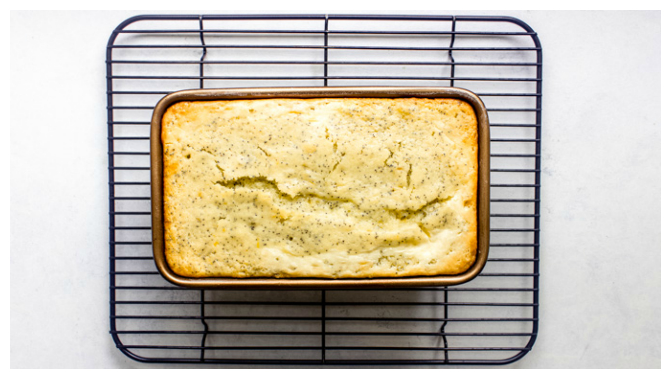 baked lemon cake on a cooling rack