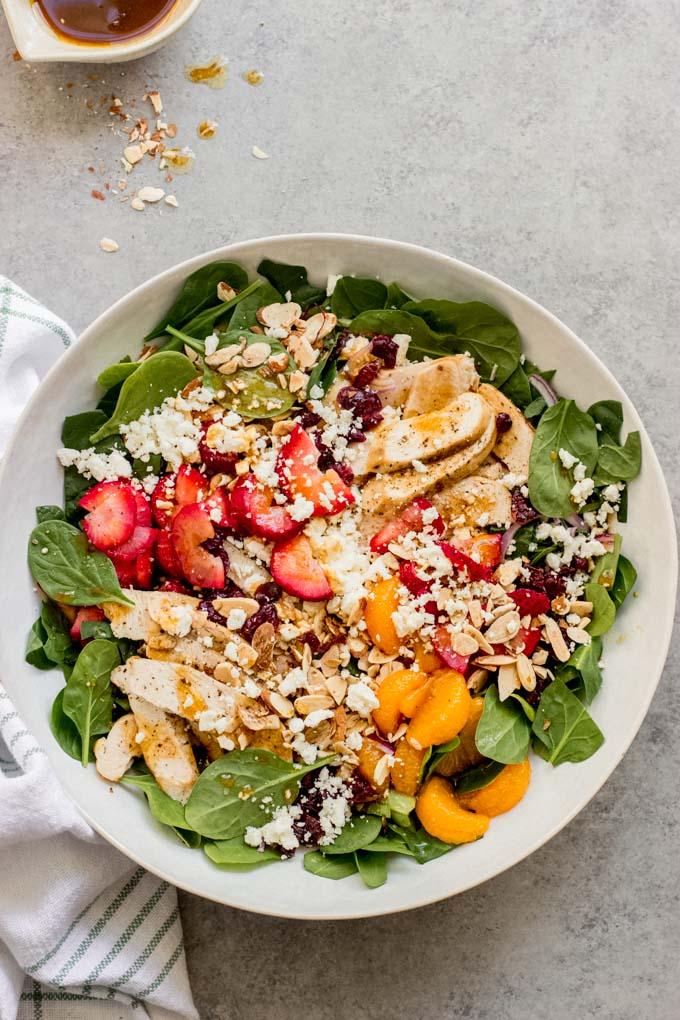 https://www.littlebroken.com/wp-content/uploads/2021/05/Strawberry-Spinach-Salad-with-Chicken-4.jpg