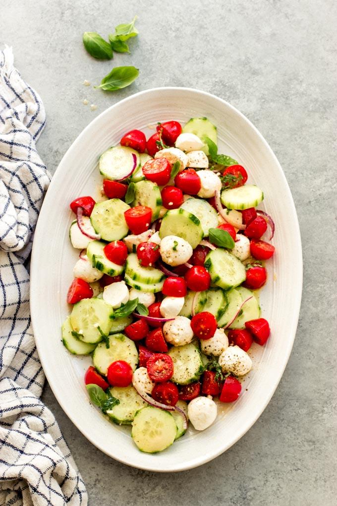 https://www.littlebroken.com/wp-content/uploads/2021/05/Tomato-Cucumber-Mozzarella-Salad-12.jpg