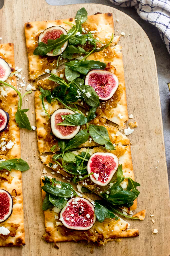close up flatbread pizza with figs and onions