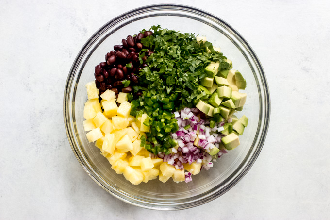 pineapple salsa ingredients in a bowl